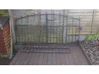 wrought iron gates and small wall railings