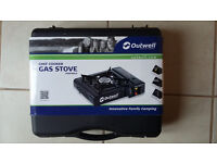 Outwell's Chef Cooker, portable gas stove, plus 2 butane gas canisters FOR SALE.