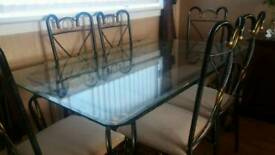 Stylish glass top dinning table and six chairs