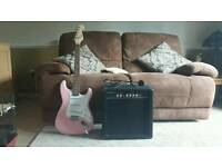 Squier Fender pink electric guitar and amp