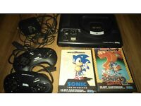 2 x Sega Megadrive consoles and games, £40 each or £70 from both ono