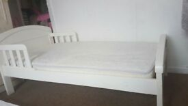 White toddler bed with mattress