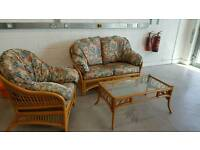 Lovely cane garden set. 2 seater. Armchair and coffee table £100 ono