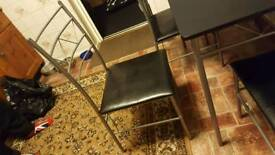 Table with 4 chairs with aluminium legs good condition