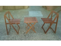 child,s brown wood folding table with 2 folding chairs