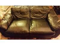 Black leather sofa and bean bag