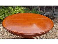 Circular Extendable Dining Table (Yew) seats up to 6 people