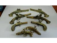 Brass plated wall decor job lot