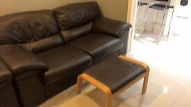 2x2 brown leather setees, with footstool, good condition, was expensive when new.
