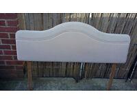 creamy pinkish padded 52 inch long headboard