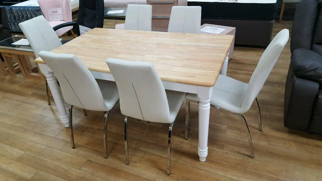 Stunning white and solid pine a 6 seater table with 6 leather and chrome chairs