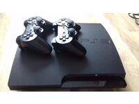 PS3 slim + 2 controllers with games and cables