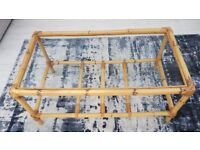 Bamboo and cane coffee table with glass top