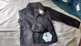 A NEW boys rain jacket