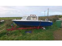 small day boat with 25hp outboard engine and trailer