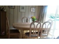 Oval Dining Table and 6 matching chairs - extendable to seat 8