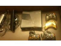 Black Xbox 360 Slim with Kinect sensor and 4 Controllers