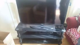 42 inch Samsung HD tv with entertainment stand