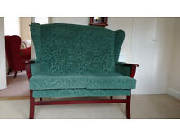 Green upholstered two seater settee