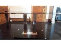 large black glass and chrome dining table