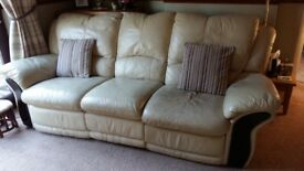 Leather three piece suite with five reclining seats.