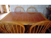 Tiled pine kitchen table & 4 pine chairs, all in good condition.