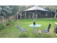garden table chairs and parasol