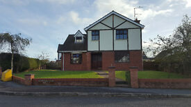 Spacious 4 bedroom detached house in Omagh with front & back garden with large driveway