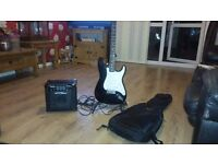 Unbranded electric guitar and amp with lead and stand
