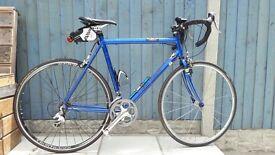 Custom Paul Milnes road bike in bright blue, 18 gears in really good condition
