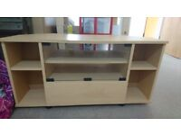 Wooden TV stand with glass front and storage