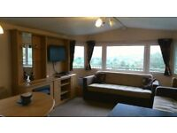 Static caravan with decking, wonderful views of White Acres. (Newquay, Cornwall) with free fishing