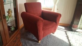 Nice sturdy red reading/nursing chair Good condition