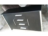 Black and chrome elements sideboard. Possibly delivery.