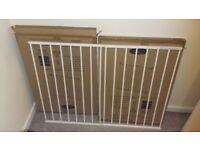 Two Babystart extending metal wall fix gate