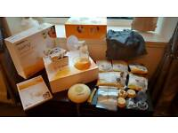 Medela Swing Electric Breast pump in box with all added extras