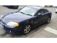 Blue Hyundai coupe 2.7 V6 engine
