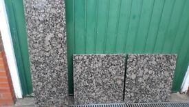 Solid stone kitchen worktops. Very heavy. Black/ brown pattern