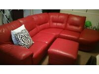 Real leather L shaped couch, lazy boy recliner and foot stool with storage