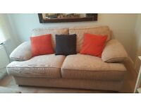 Two seat sofa (total length 1,9m or 75 inches). Matching stool (30 × 24in) Both good condition