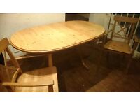 Sturdy dining table and two carver chairs