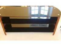 TV stand like new, wooden sides, black glass shelves