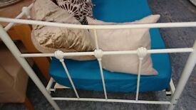 Cream metal day bed with mattress