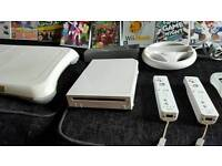 Nintendo Wii including Wii fit board, selection of games and other accessories