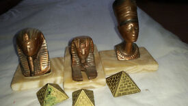3 copper spinx paperweights on marble base