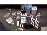 Nintendo Wii u + 5 games and accessories.