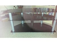 """Black glass TV stand will fit 50 """" flat screen TV. Has tunnel to hide cables"""