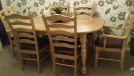 6 seater light oak wooden dining room table and chairs (2 x carvers)