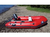 ***Reduced *** 3 man dinghy with 2 hp motor and launch trolley