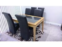 Dining table with 6 dark brown chairs £150 ono Collection Only